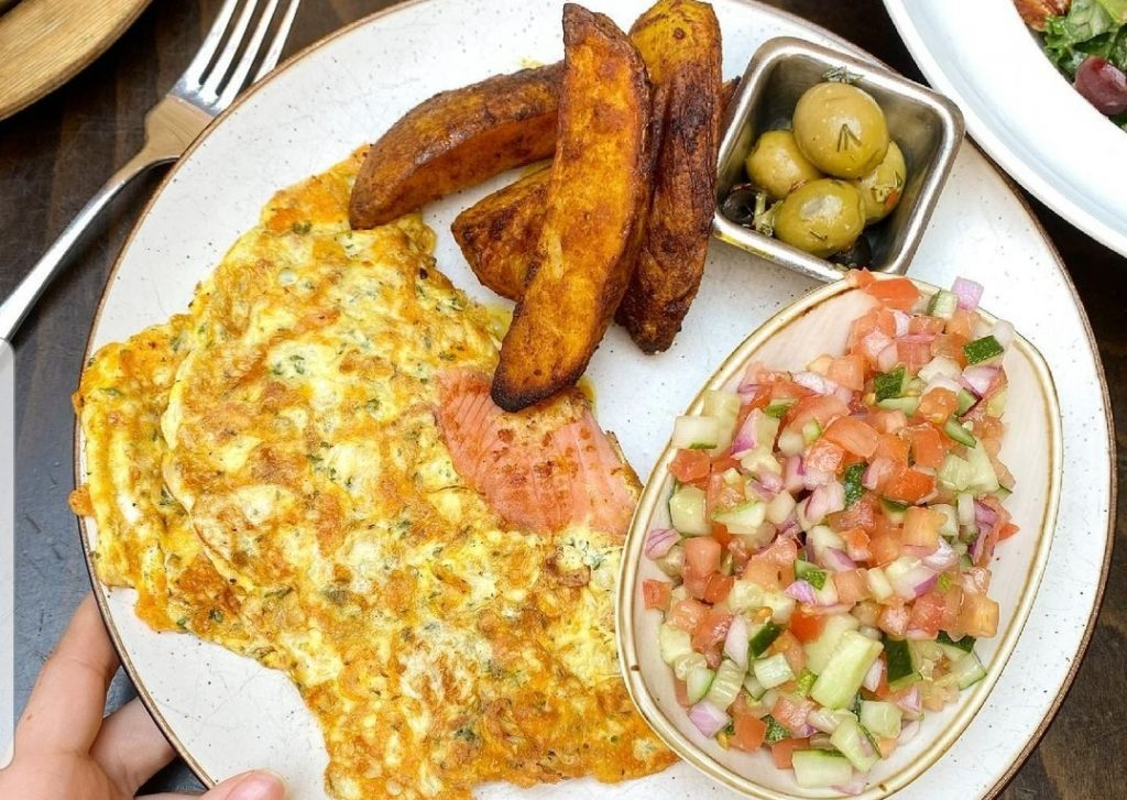 Breakfast Special at Mozzarella Crown Heights with scrambled egg, Israeli salad and potato wedges