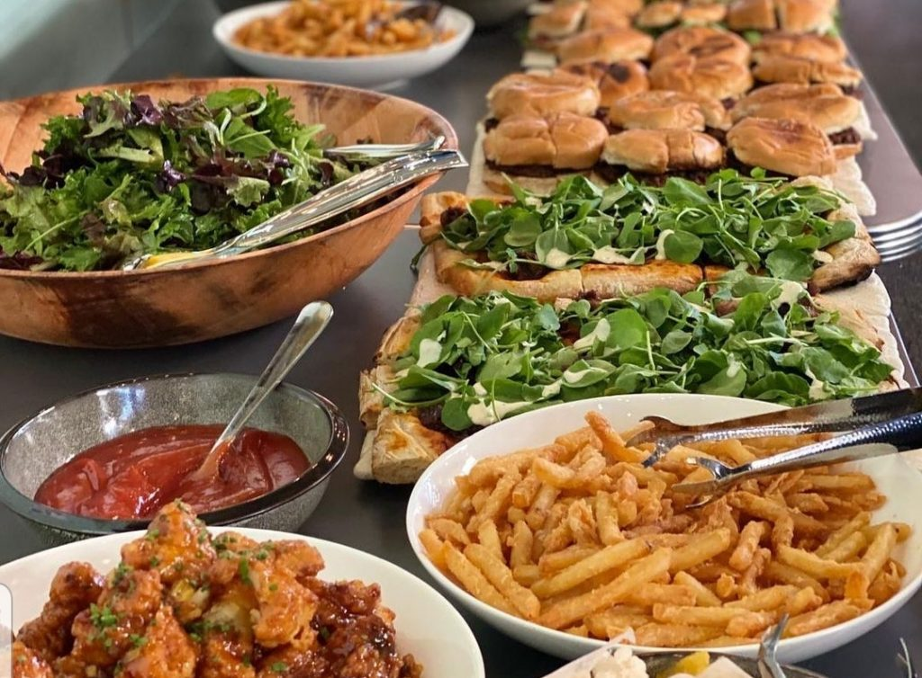 burgers, meat pizza, salad, chicken poppers, pasta salad at Gruit Brooklyn