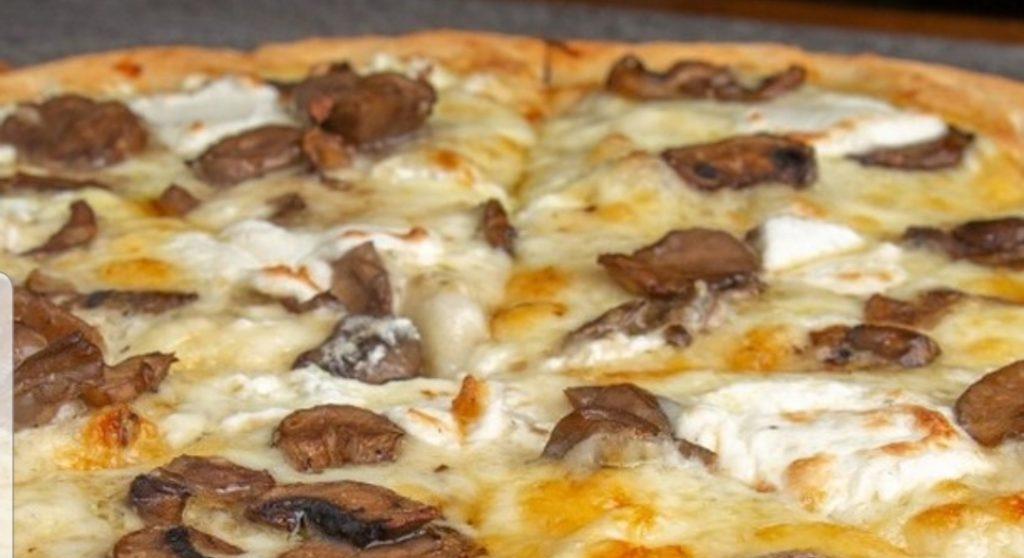 mushroom pizza with fresh mozzarella cheese at Cafe Noir, Miami