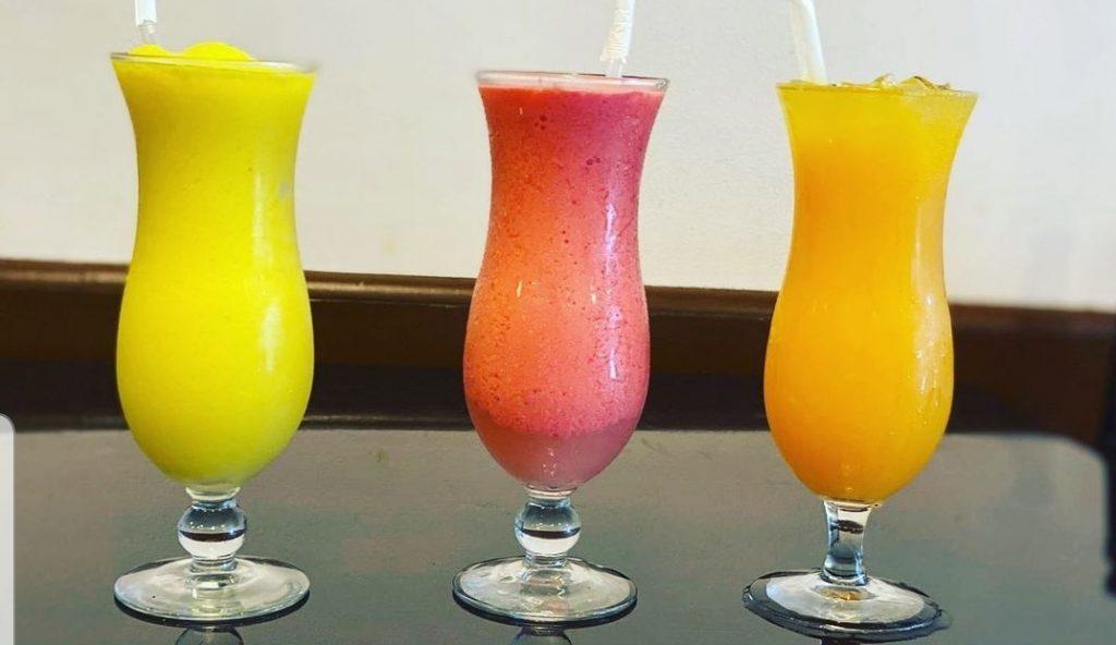 yellow red or orange smoothie at Holy Bagel Miami