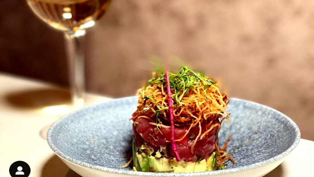 tuna tartar with avocado and microgreens