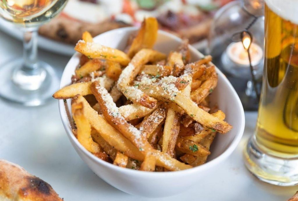 house made basil spiced fries with parmesan cheese at Basil in crown hieghts