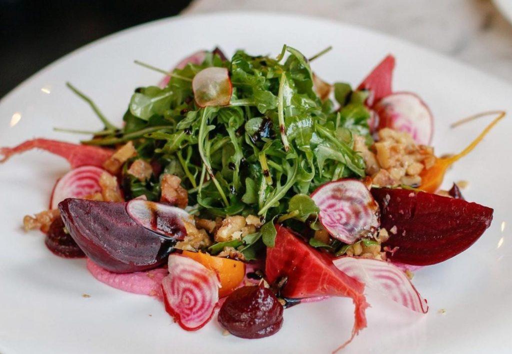 salad from Basil in Crown hights with arugula, beets, rainbow radish, orange