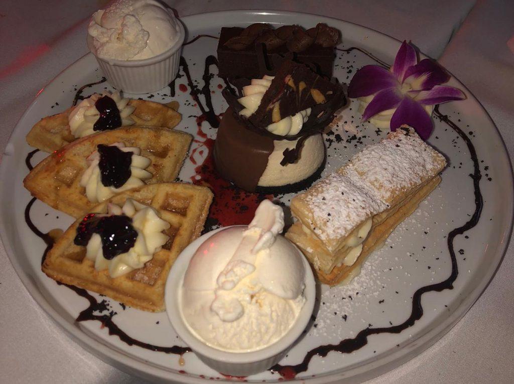 ice cream, neapolitan cake, waffles, whipped cream chocolate cake, cheese cake dessert at Pescada dairy