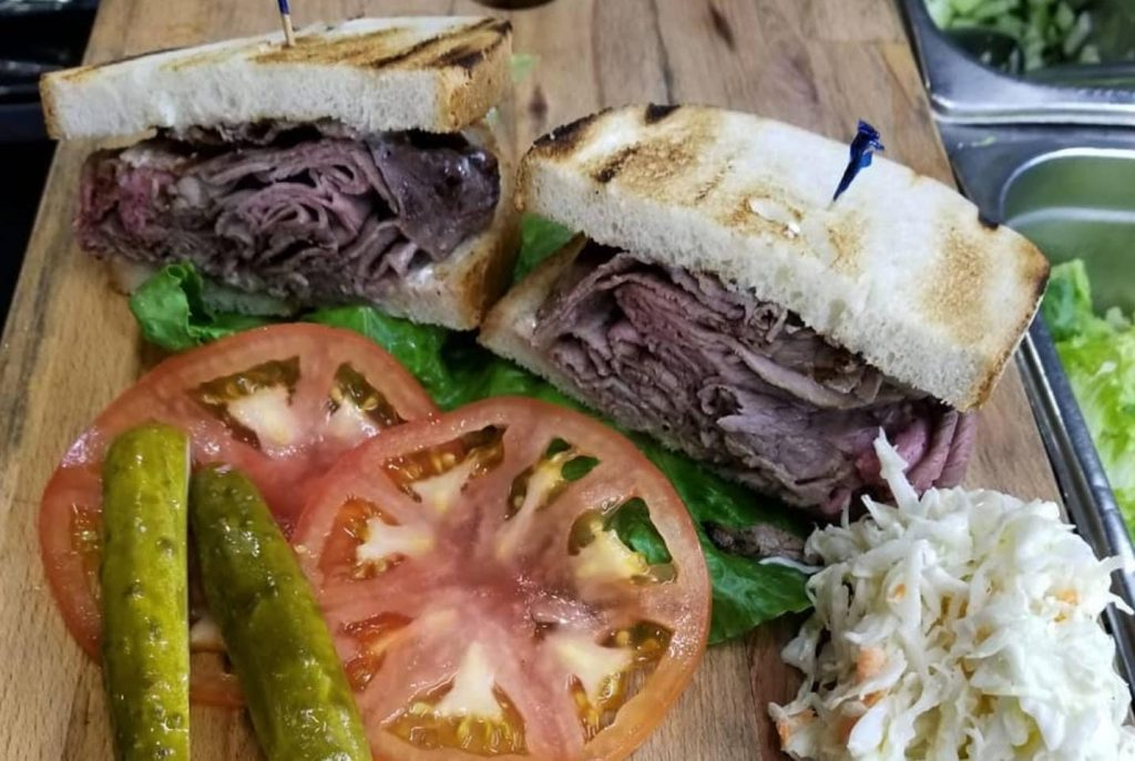 rye bread sandwich with pastrami and vegetables