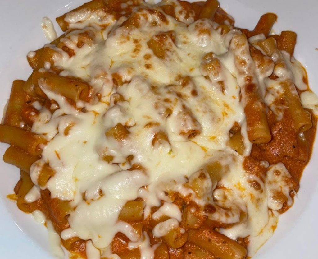 tomato sauce pasta with extra cheese ontop