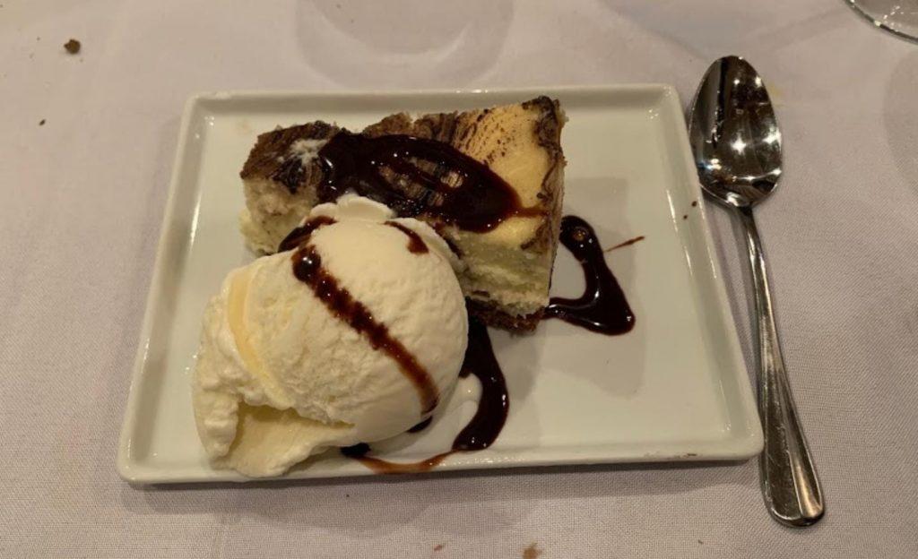 cheesecake and vanilla ice cream with mocha sauce on top