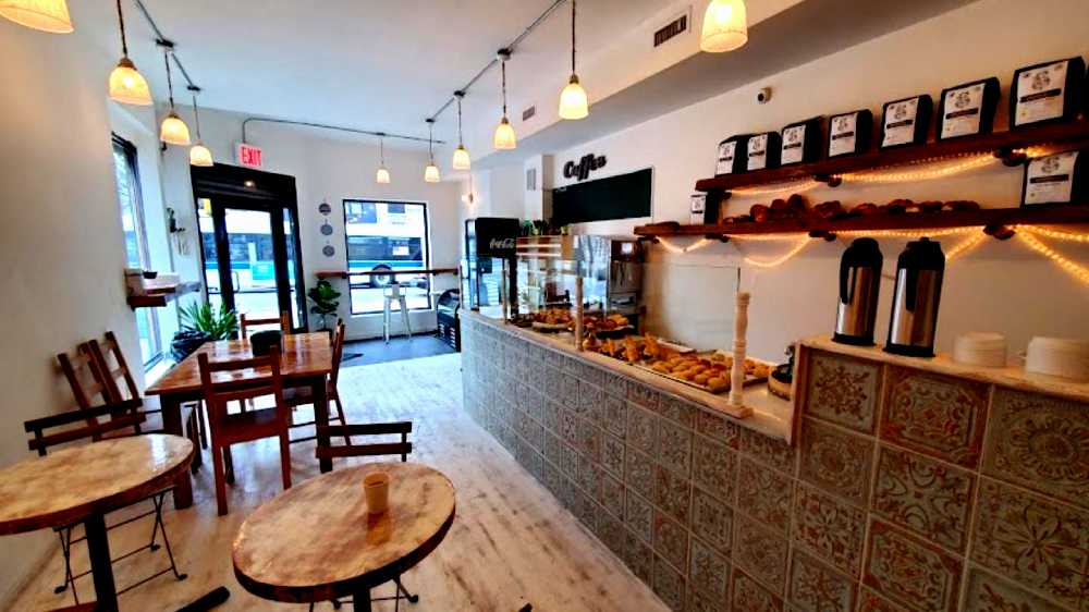 inside Almah Cafe, tiled countertops and wooden tables