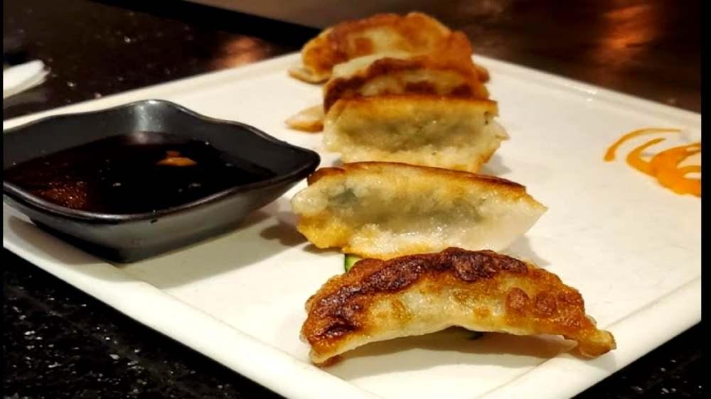 pan fried dumplings with soy sauce