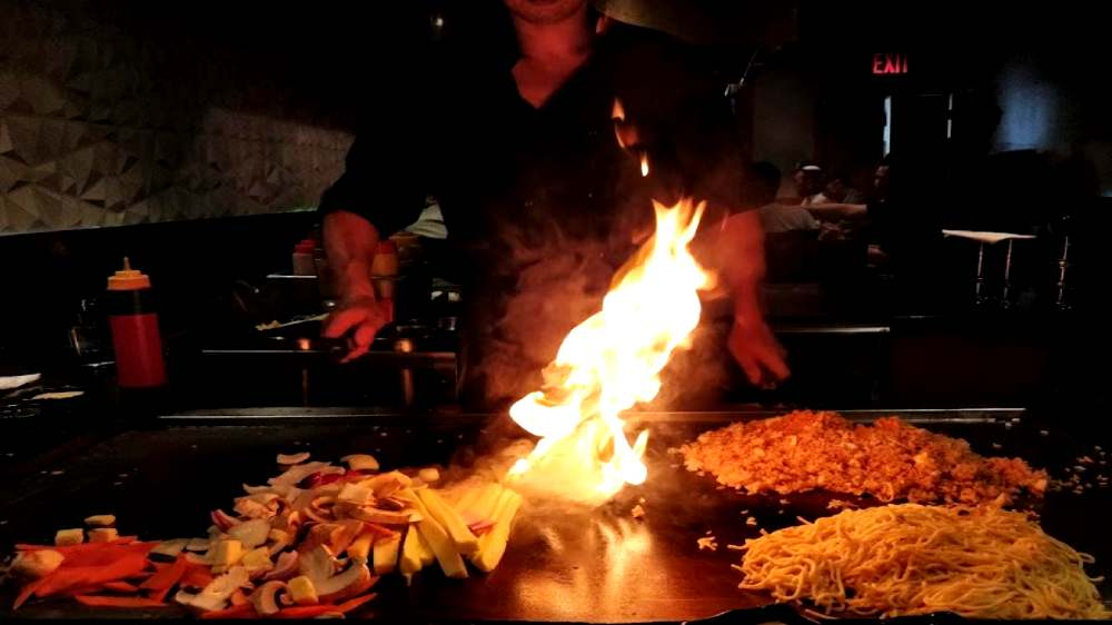 chef in action at Kasai Hibach