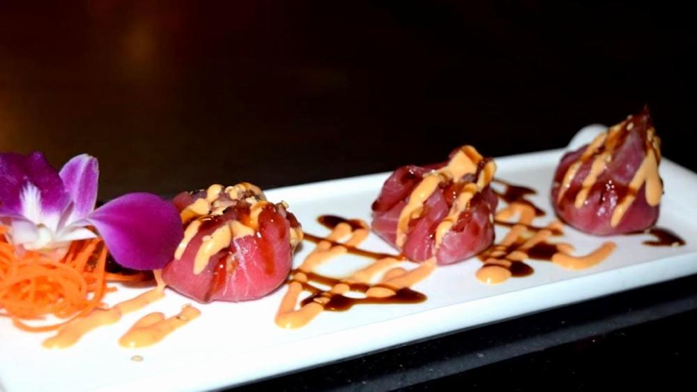 sashimi with sweet sauce and spicy mayo